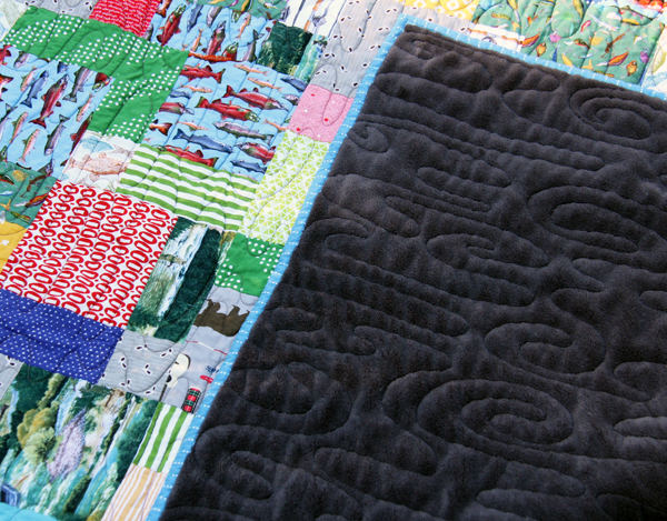 Using a blanket for a quilt back