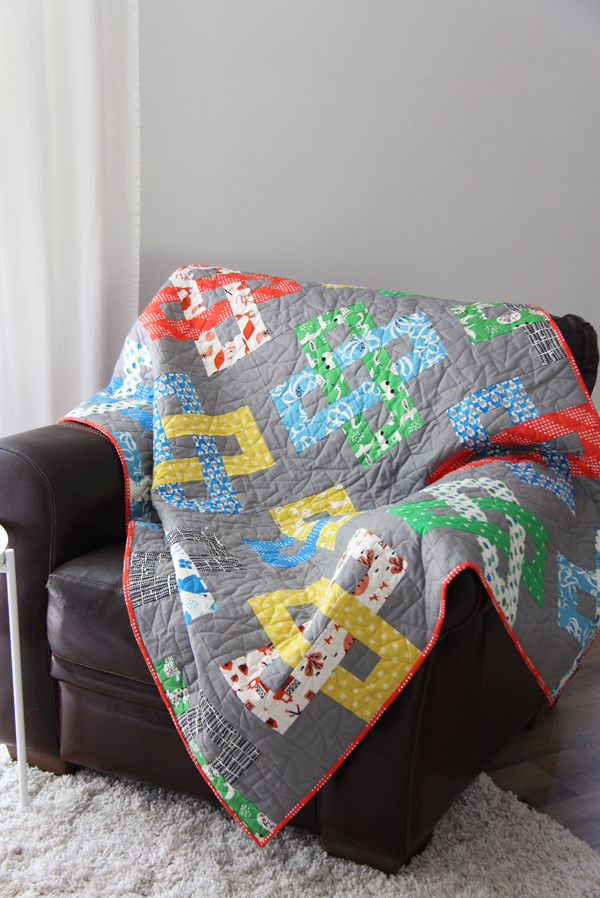 Simplify Quilt Pattern, a simple jelly roll quilt in 5 sizes